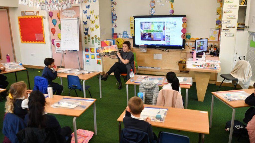 A teacher in a socially-distanced classroom