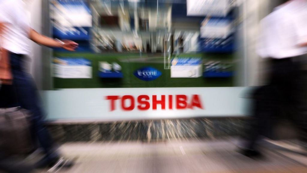 Troubled Toshiba flags deeper losses