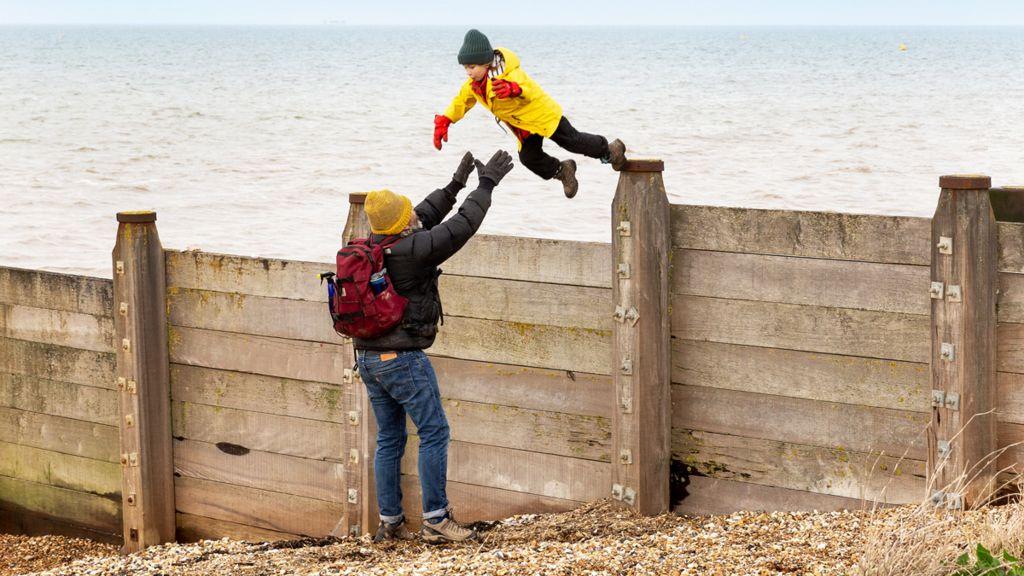 Man catches a jumping boy