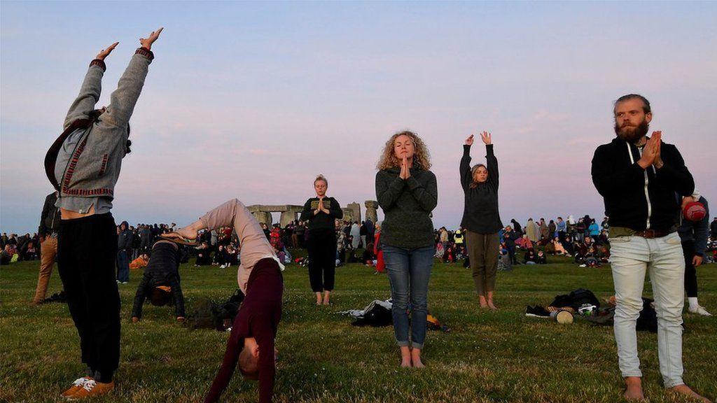 People doing Yoga at Stonehenge