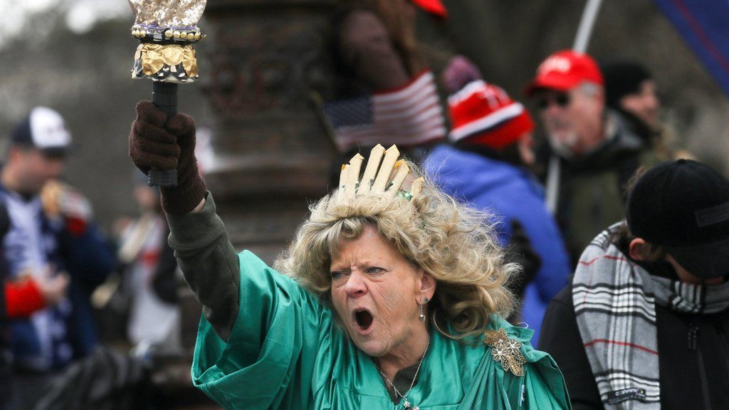 Leigh Ann Luck dressed up as the Statue of Liberty shouts as supporters of President Donald Trump gather near the Capitol building in Washington