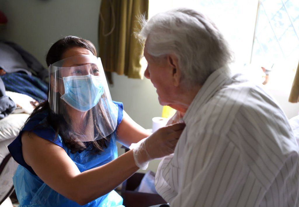 Picture of an elderly patient being looked after