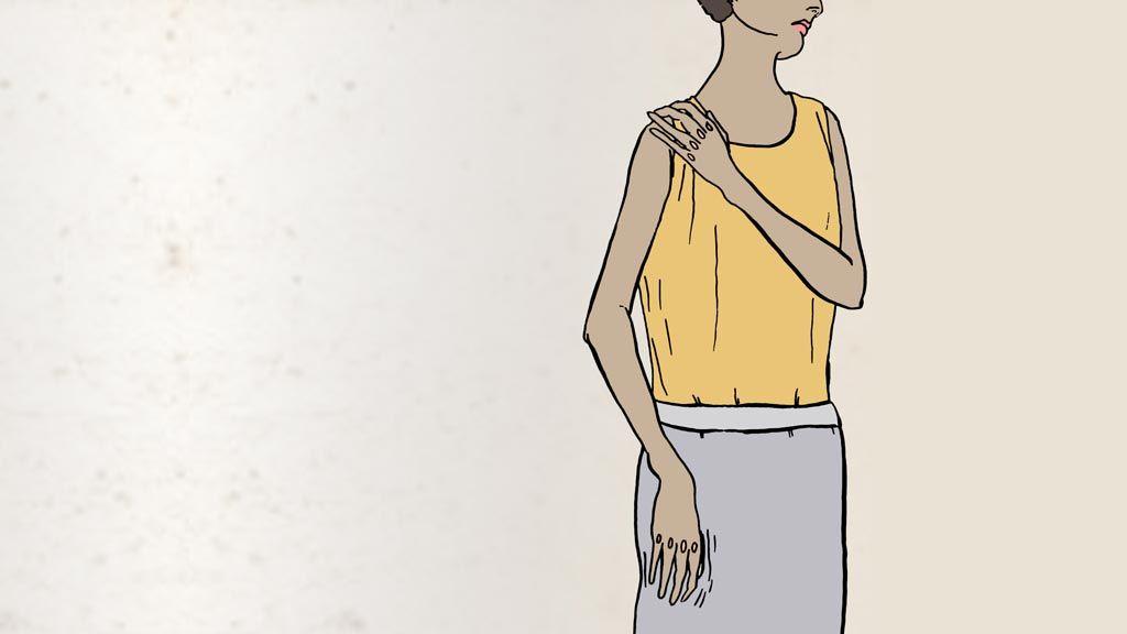 Women holding shoulder