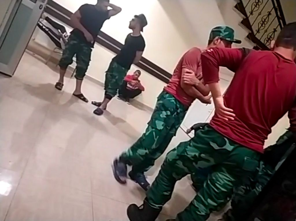 A shot apparently of Syrian fighters in a barracks in south-western Azerbaijan - they are wearing the aqua-tinted fatigues of the Azeri border guard service