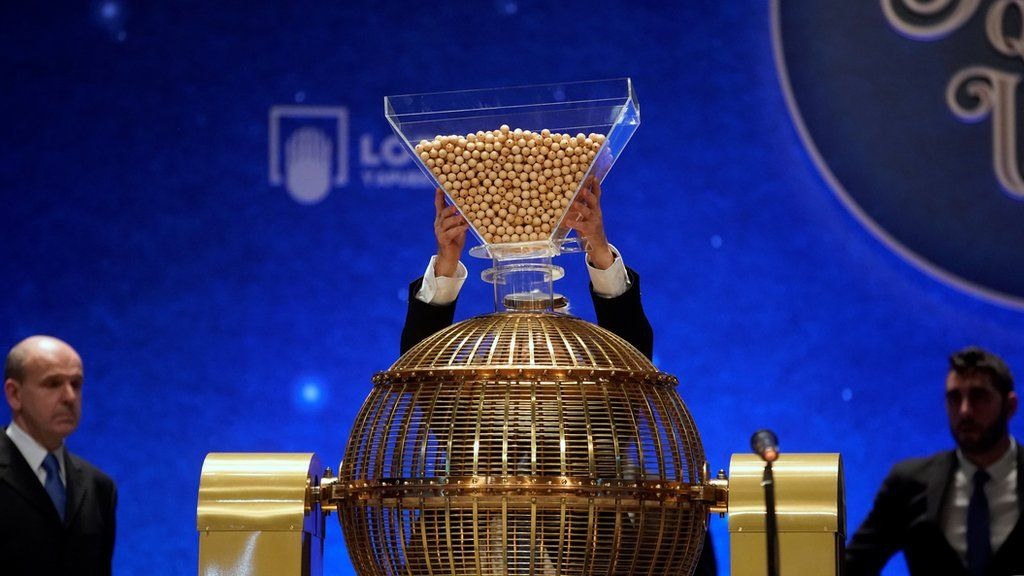 Lottery balls are dropped into a rotating drum during the draw.
