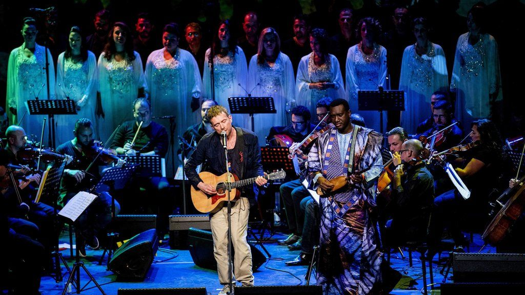 Damon Albarn performs with The Orchestra of Syrian Musicians