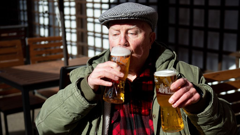 Enjoying two pints, Birmingham, 12 April 2021
