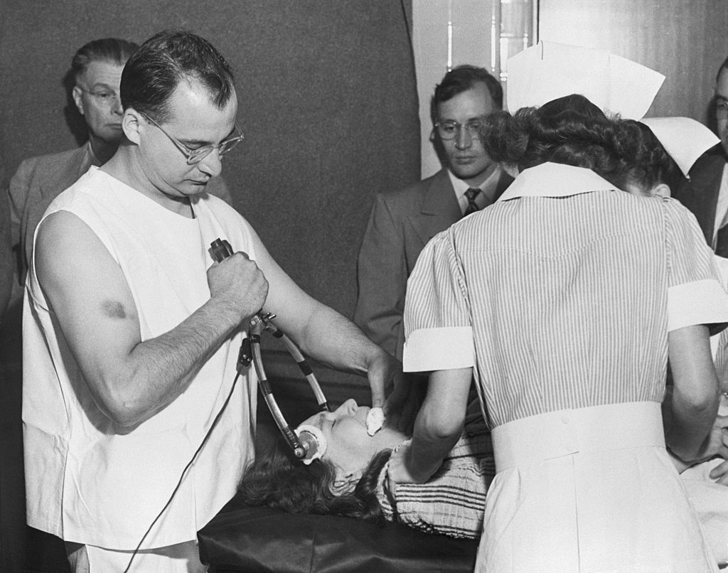 Freeman's colleague Dr James Shanklin uses electrical apparatus to prepare a patient for transorbital lobotomy