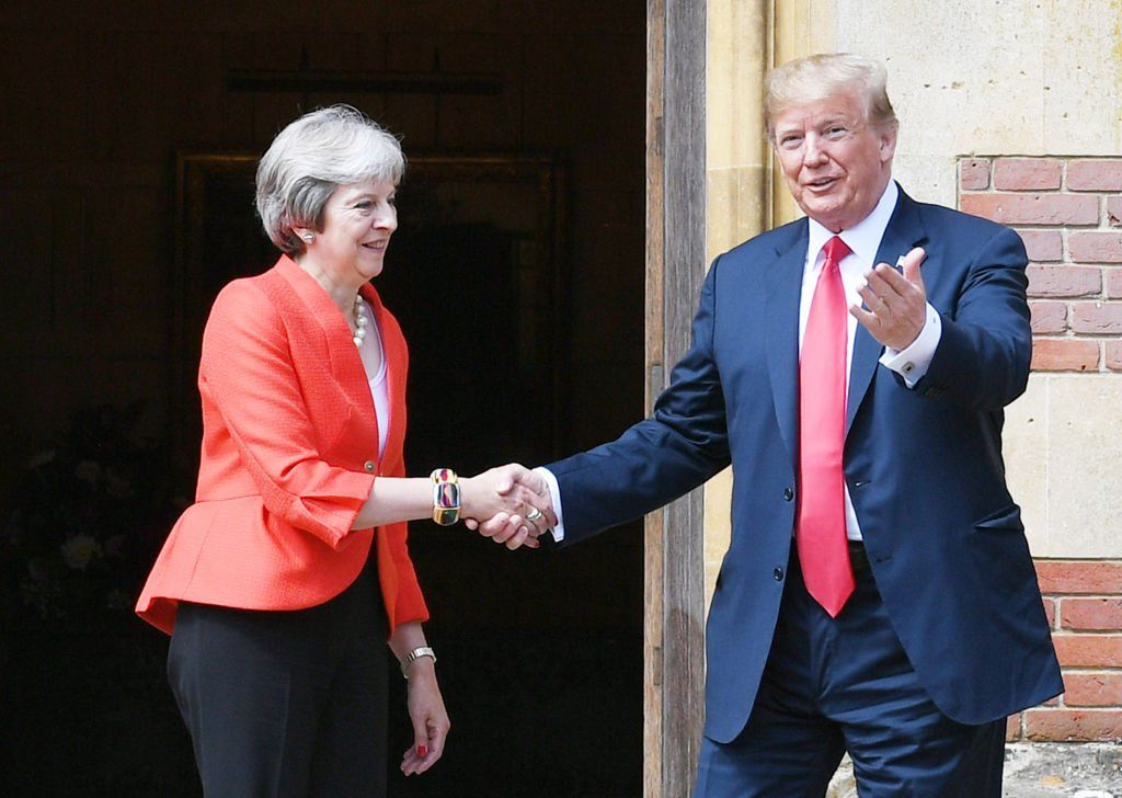 Donald Trump and Theresa May shaking hands outside Chequers