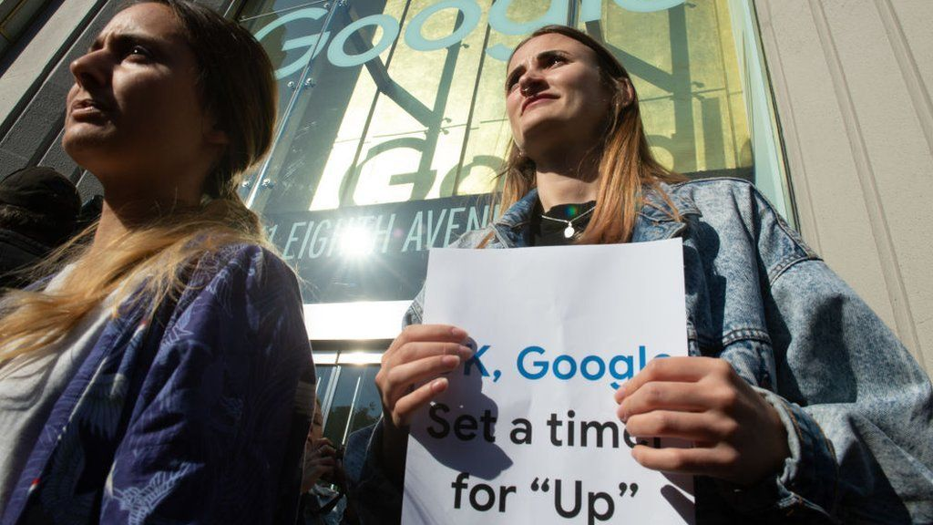 Google staff walk out their office in New York in November 2018