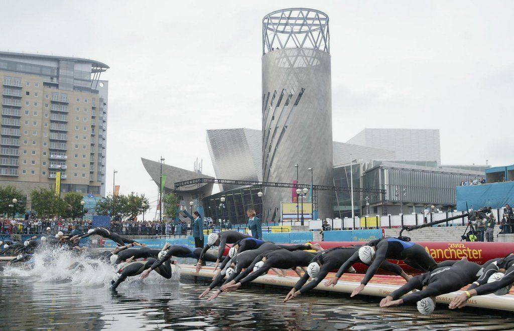 swimmers dive in outside the Lowry Theatre