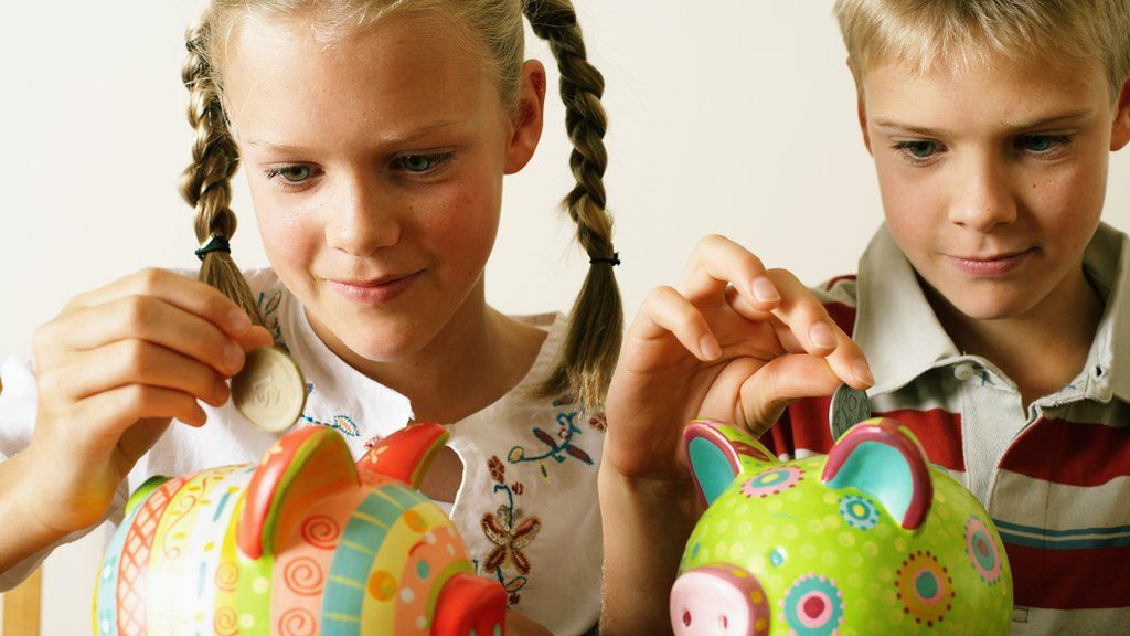 Girl and boy with piggy banks