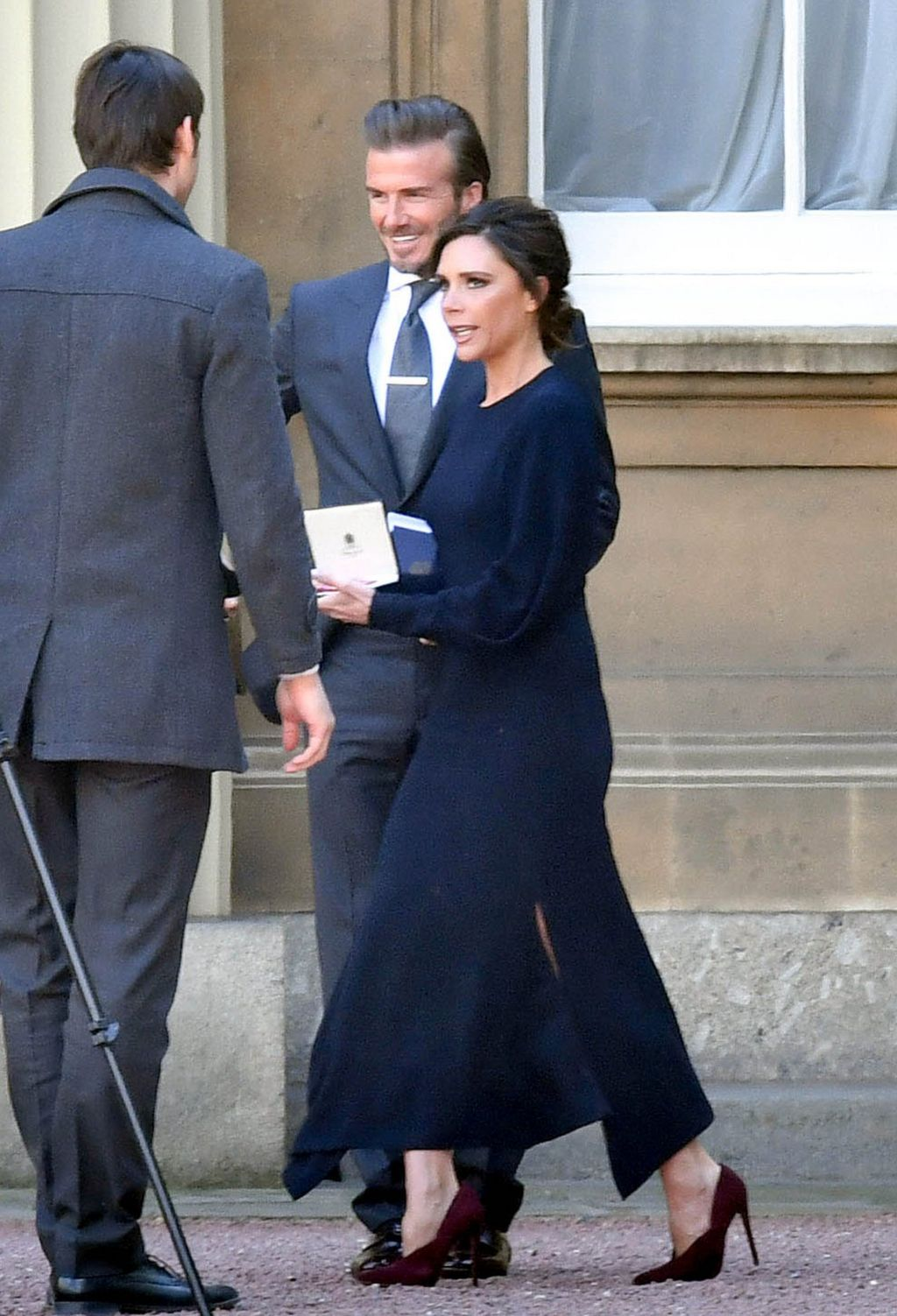 Victoria and David Beckham outside of Buckingham Palace after she received her OBE