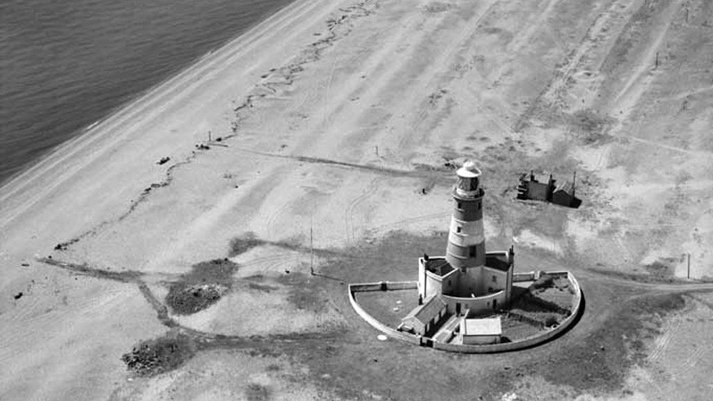 Aerial view of Orfordness Lighthouse taken in 1951 from Historic England Britain from Above archive