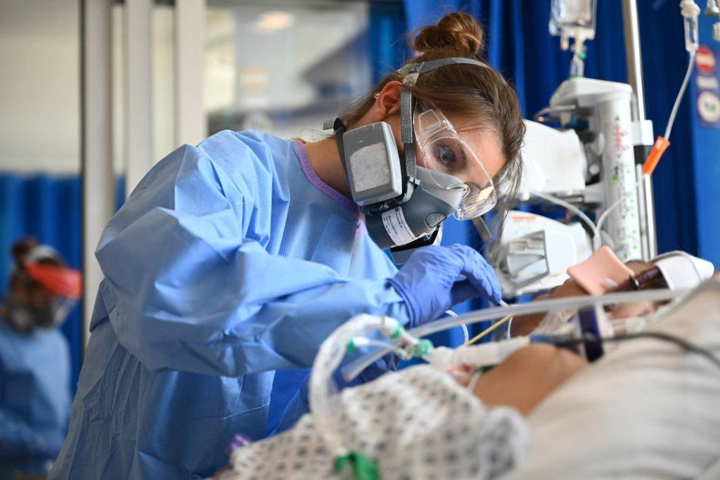 Staff care for a patient in critical care at Royal Papworth hospital in Cambridge
