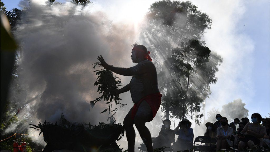 Indigenous performers hold a smoking ceremony as part of the WugulOra Morning Ceremony at Barangaroo Reserve