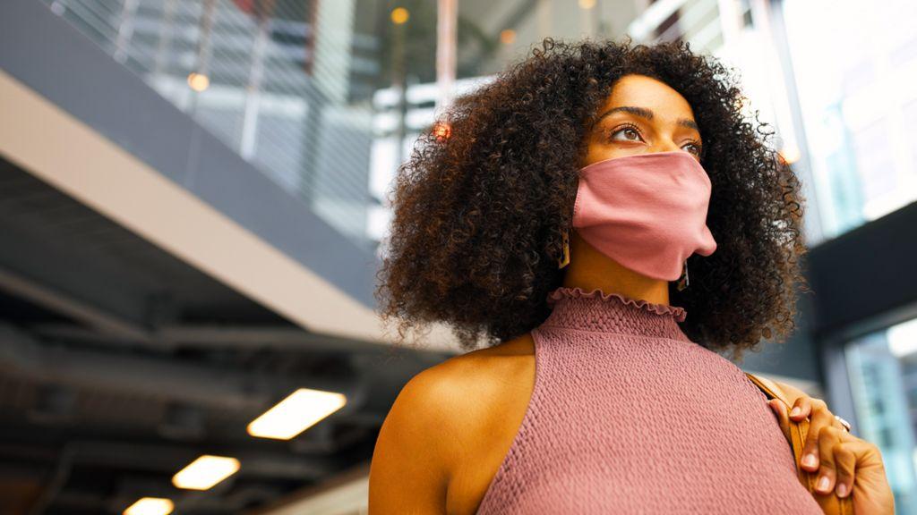 Office worker in mask