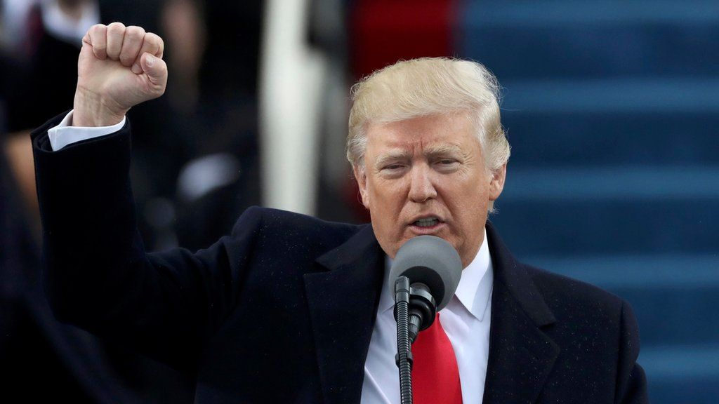 Donald Trump pumps his fist after being sworn in as the 45th US president
