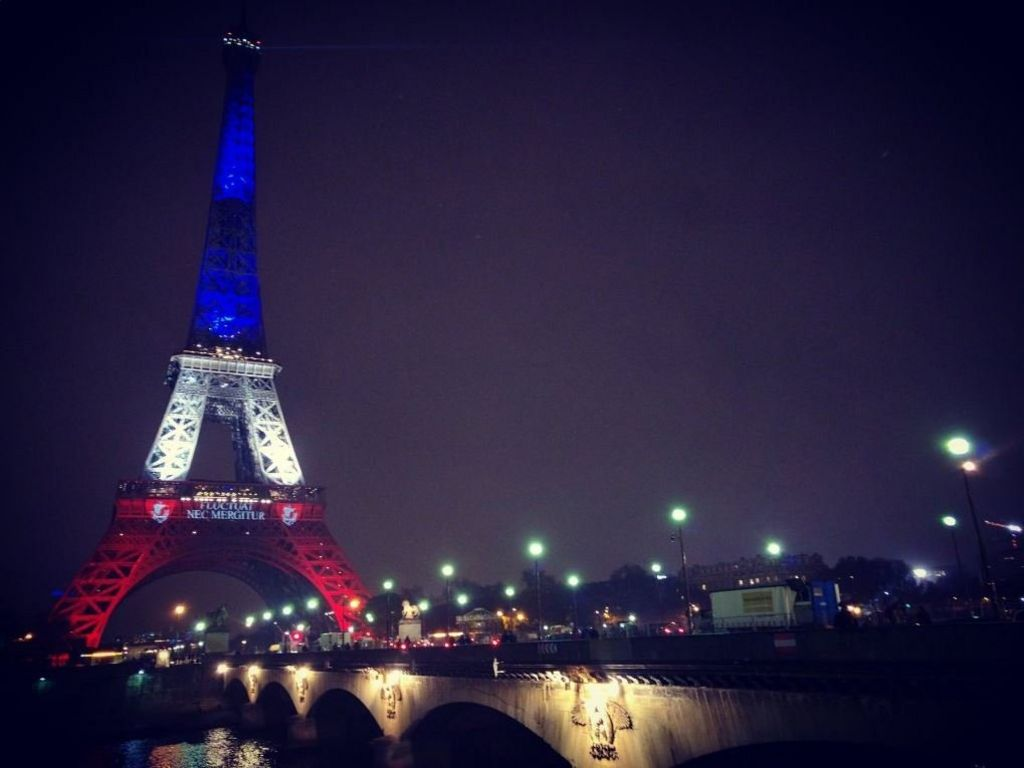 Eiffel Tower lit with the colours of France's Tricolour flag