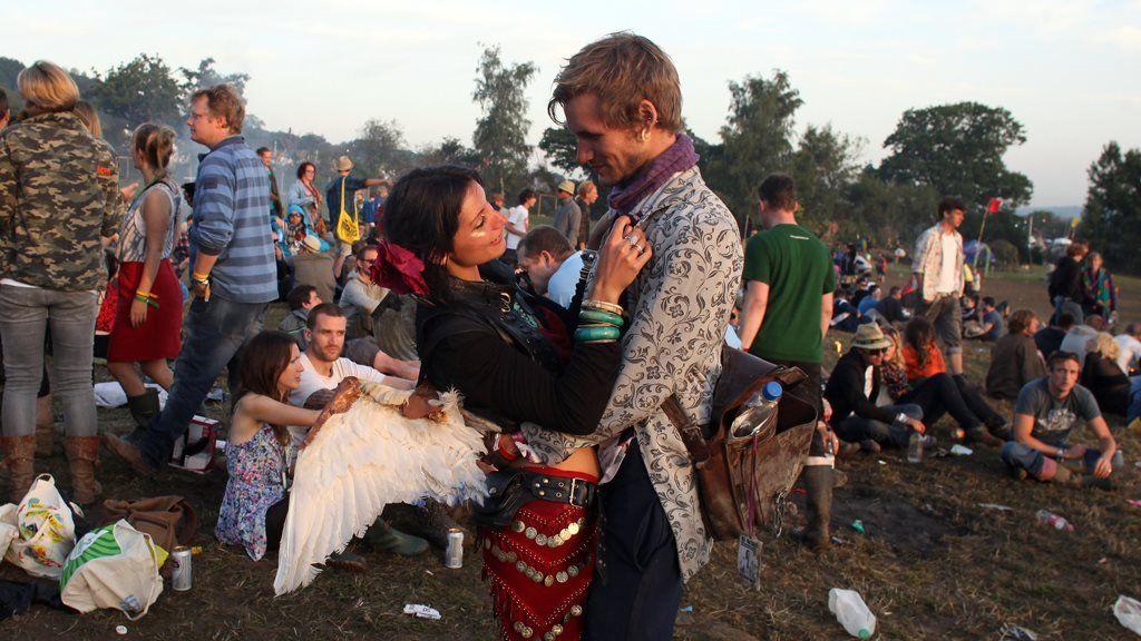 A couple hug at Glastonbury in 2011