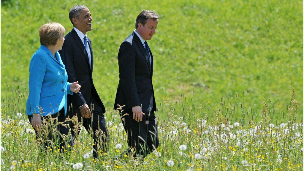 Obama, Merkel and Cameron in a meadow at the G7 in Germany