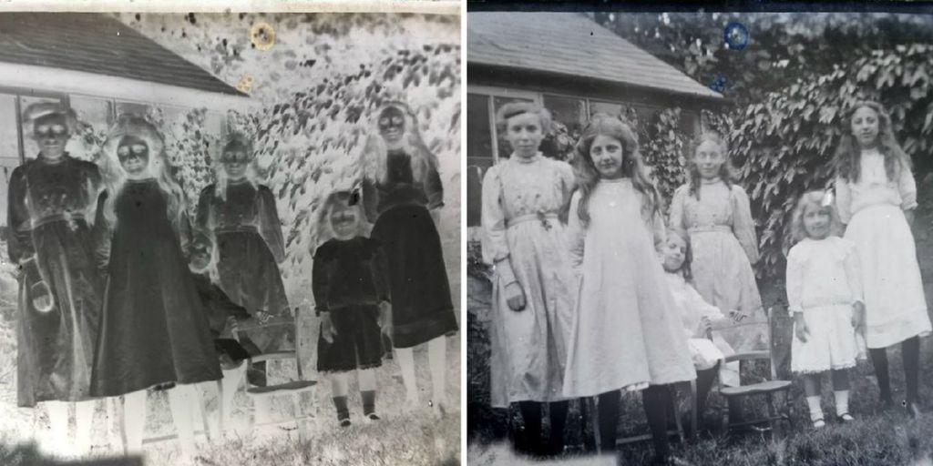 Children wearing white dresses and flower garlands smile at the camera