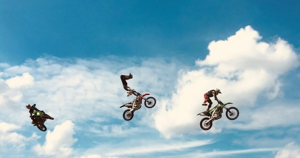 Three motorcycles in the air