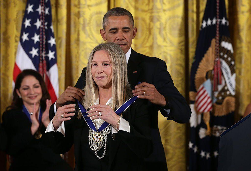Barbra Streisand receives the Presidential Medal of Freedom from Barack Obama