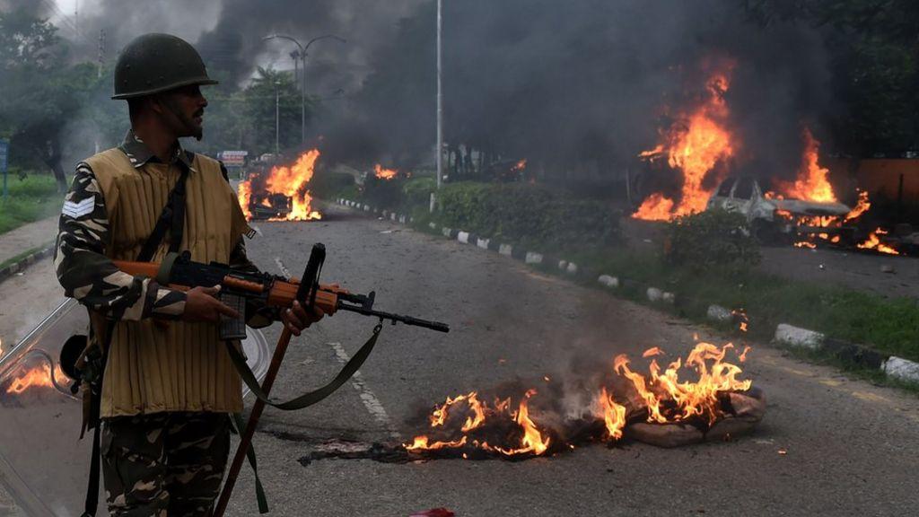 India guru rape case: 12 die in unrest as Ram Rahim Singh convicted