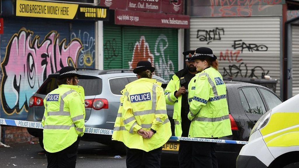 Moss Side shooting  Two men arrested over carnival attack - BBC News 8ab79bb3682dd