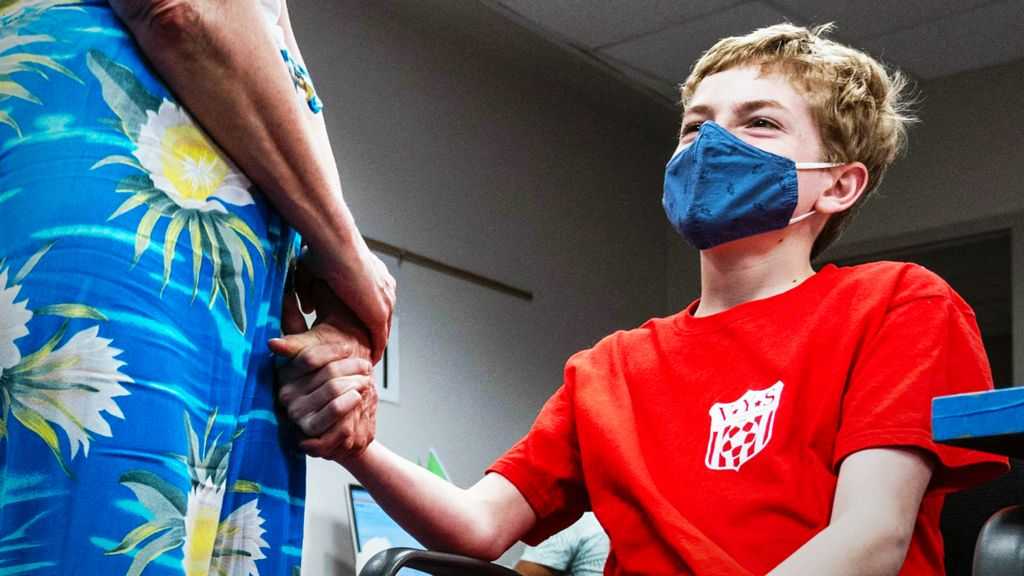 Boy waiting for a vaccine in the US