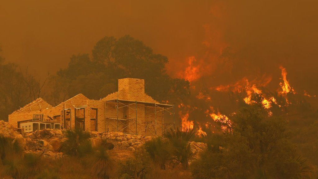 Flames surround a property under construction off Copley Road in Upper Swan on 2 February 2021 in Perth, Australia
