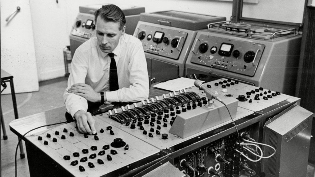 George Martin at the mixing desk