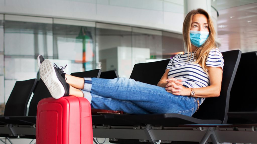 Woman wearing a mask at an airport