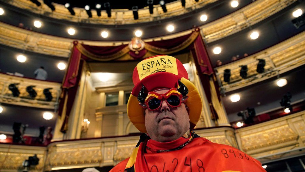 A man is dressed up before the start of the Christmas lottery draw in Madrid.
