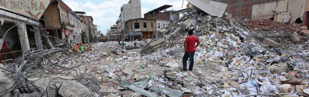 A man stares at the rubble in Portoviejo, Ecuador on April 20, 2016