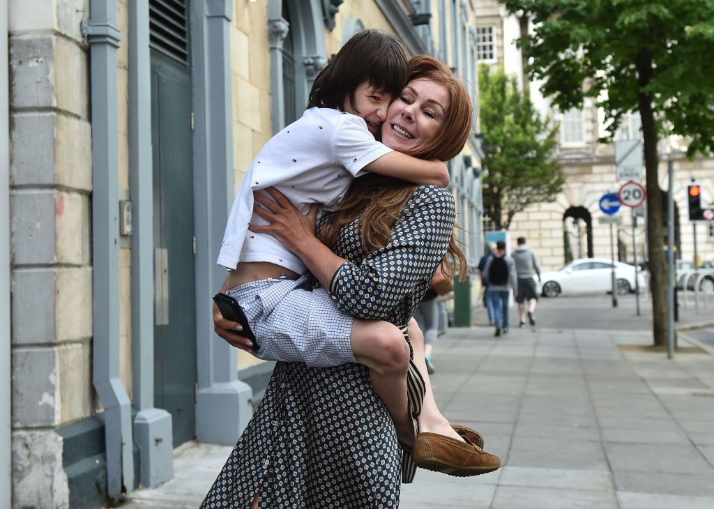 charlotte caldwell hugging her son billy