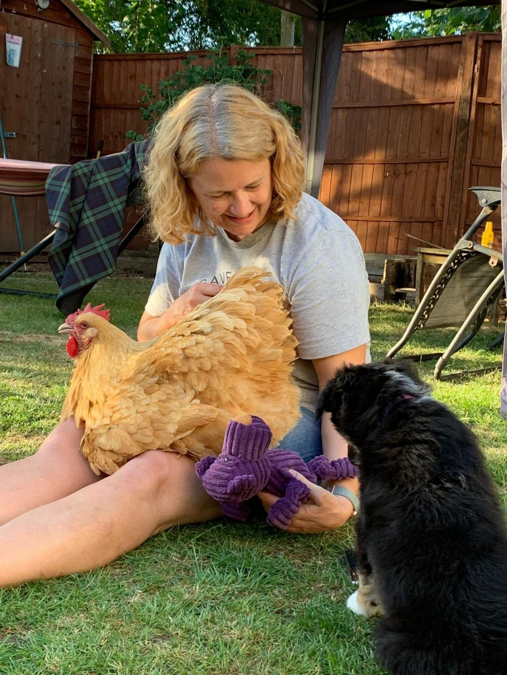 Sarah Chidwick at her home in Claverham with one of her chickens and her dog