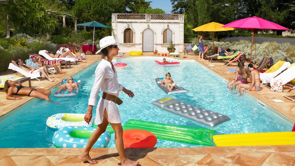 Relaxing by a French swimming pool