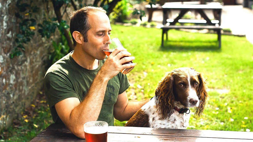 Man and dog in a pub garden