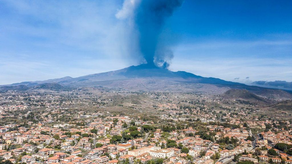 Mount Etna erupting, seen during the daytime