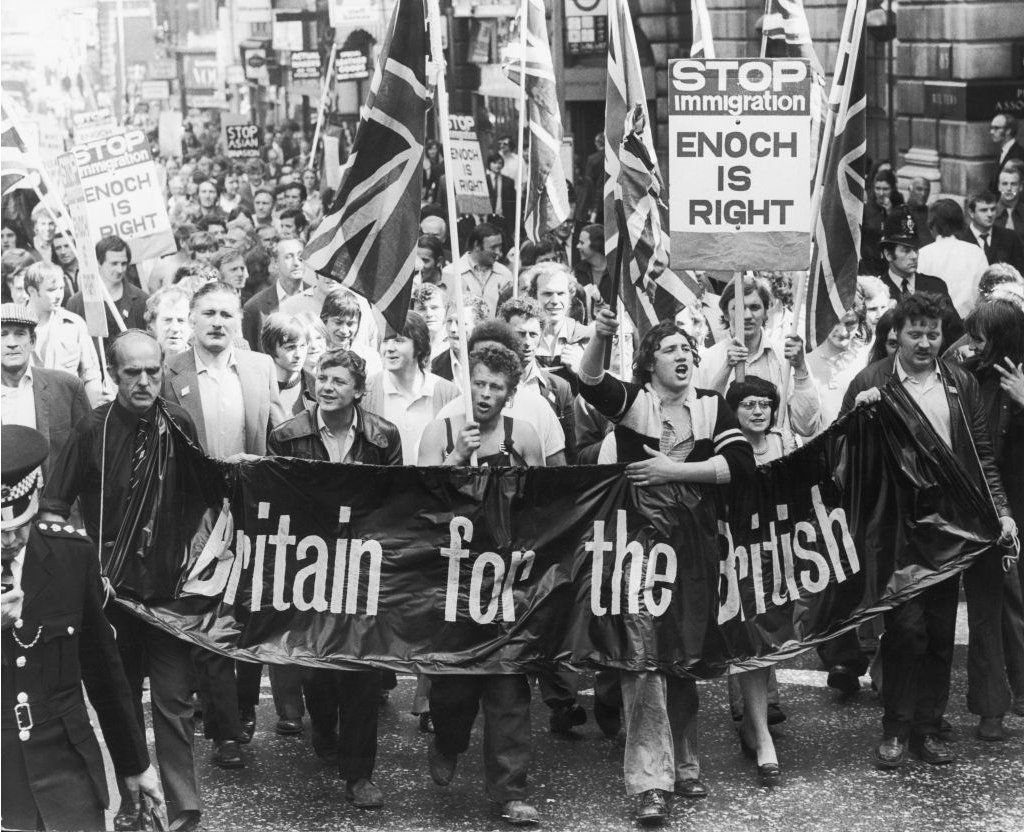 """Meat porters march on the UK Home Office in 1972, bearing a """"Britain for the British"""" banner"""