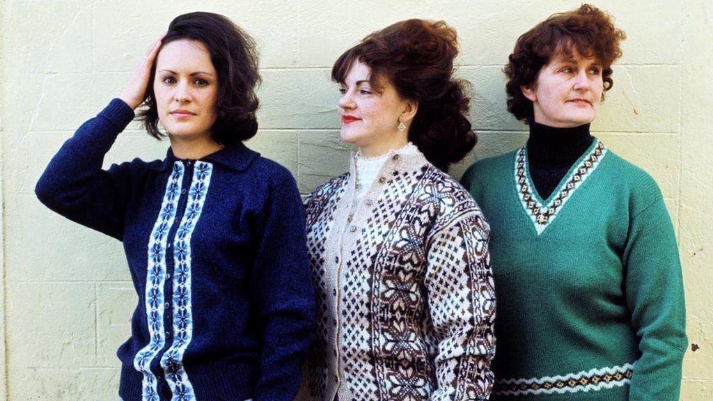 Three women pose wearing Fair Isle sweaters in Lerwick in 1970.