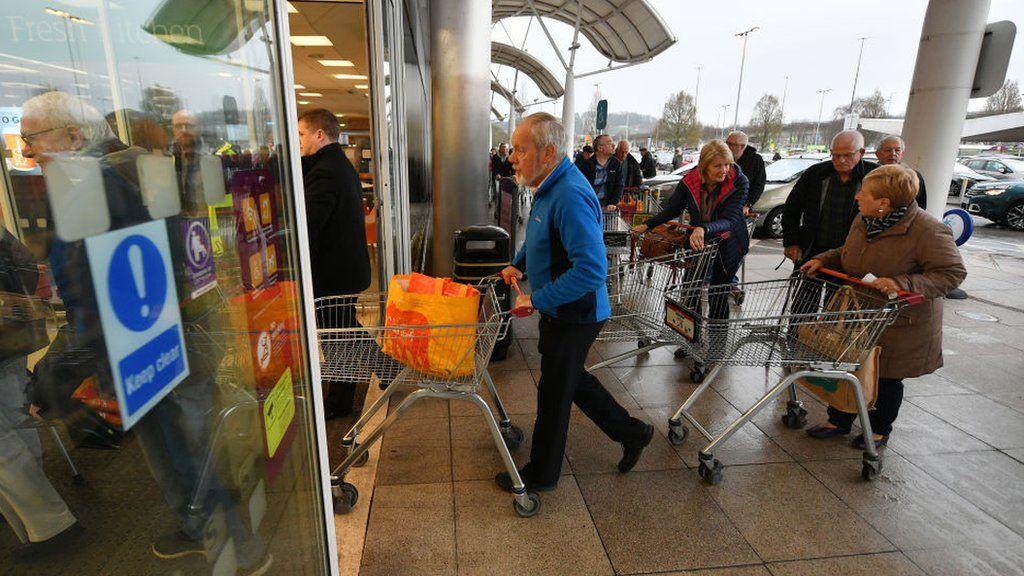 Shoppers queue to enter Sainsbury's