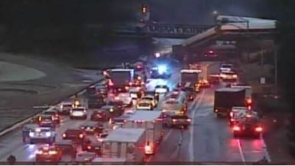 Washington train crash: Rail carriage falls on US motorway