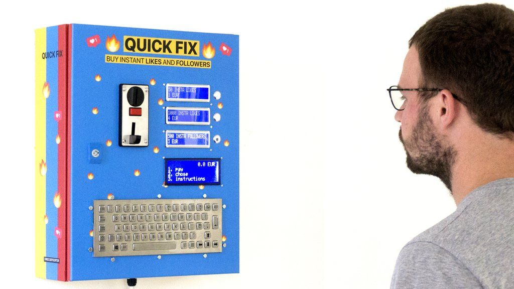 Dries Depoorter standing in front of his Quick Fix vending machine