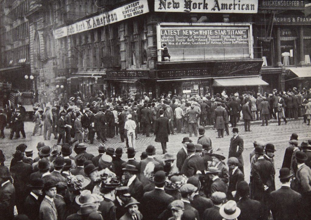 As the reports of the disaster arrived in New York, April 1912, people gathered around newspaper bulletin boards