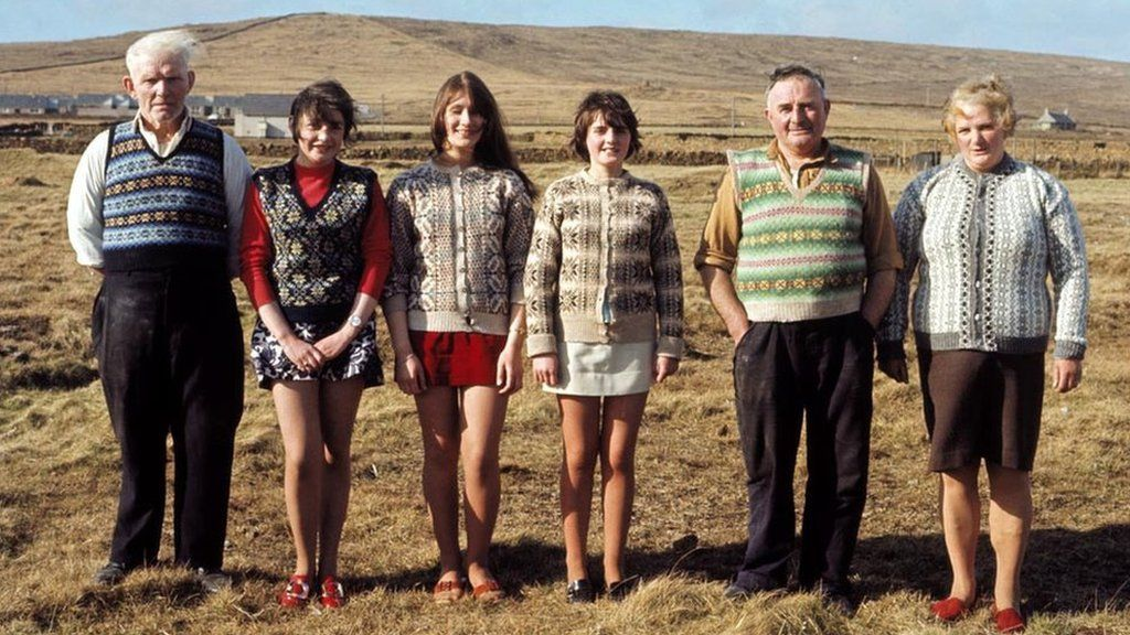 A family of Shetlanders pose wearing Fair Isle jumpers and tank tops on one of the Shetland Islands in June 1970