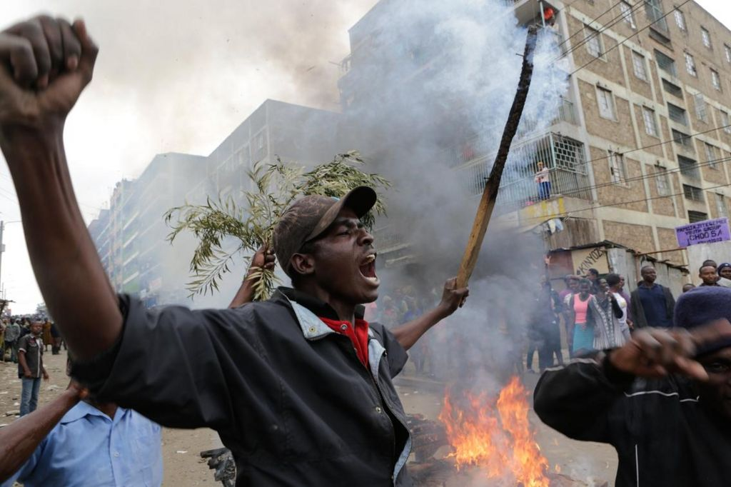 Opposition supporters in Mathare slum protest against early election results giving Raila Odinga the lead.
