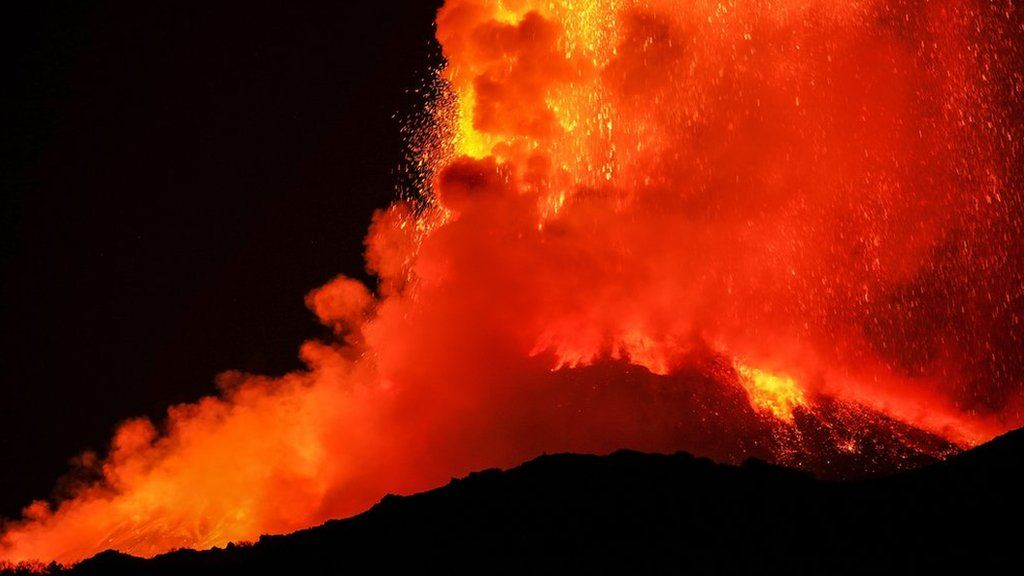 Lava fountains spewing from the top of the volcano